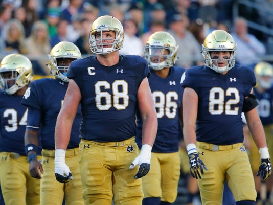 "FILE - In this Sept. 30, 2017, file photo, Notre Dame offensive lineman Mike McGlinchey (68) looks up at the scoreboard during the first half of an NCAA college football game against Miami (Ohio) in South Bend, Ind. ""Offensive line's the only position in sports where you have five guys going as one, and we take a lot of pride in that,"" senior left tackle Mike McGlinchey said this week as No. 9-ranked Notre Dame (6-1) prepared for Saturday's visit by No. 14 North Carolina State (6-1).(AP Photo/Charles Rex Arbogast, File)"