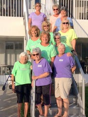 Ladies that make up The Ladyfish Lounge are proud of their fishermen. From top left,  Marilyn Thomas, Jo Latham, Carol Schoenherr, Marge Schoenherr, Barb Dawes, Mary Young, Jackie Schreier, Thelma Feldman, Louetta Goggin, and Nancy Britner.