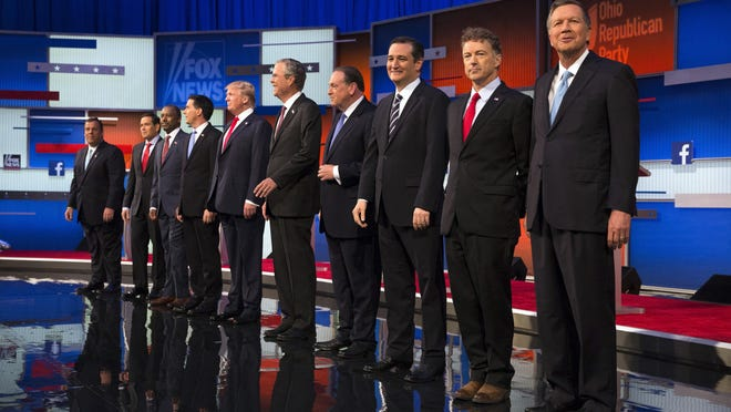 Republican presidential candidates from left, Chris Christie, Marco Rubio, Ben Carson, Scott Walker, Donald Trump, Jeb Bush, Mike Huckabee, Ted Cruz, Rand Paul and John Kasich take the stage for the first Republican presidential debate at the Quicken Loans Arena Thursday, Aug. 6, 2015, in Cleveland.