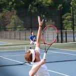 Tanner Wilcox of Harper Creek High School serves during the Harper Creek Optimist City Tennis Tournament Saturday morning.