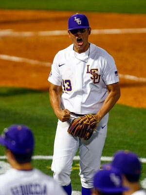LSU pitcher Todd Peterson  reacts after the third out as he walks off the field during the eighth inning of a Southeastern Conference tournament NCAA college baseball game against Mississippi State on Tuesday, May 22, 2018, in Hoover, Ala. (AP Photo/Butch Dill)
