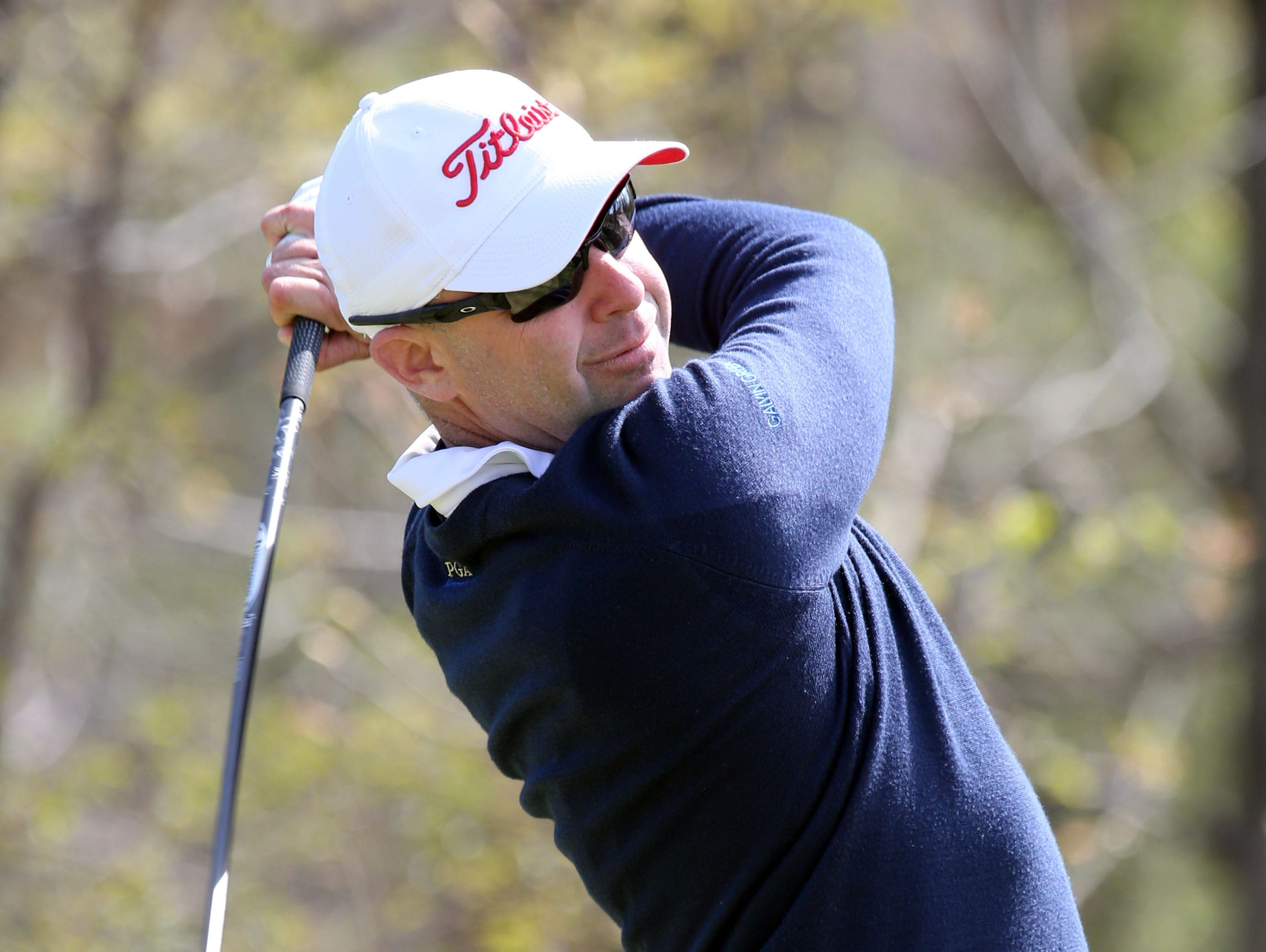 Rob Labritz from the GlenArbor Golf Club hits a tee shot as he plays against Steve Scott from the Paramount Country Club, during the match play final of the MasterCard Westchester PGA Championship at the Apawamis Club in Rye, April 30, 2015. Labritz won the championship.