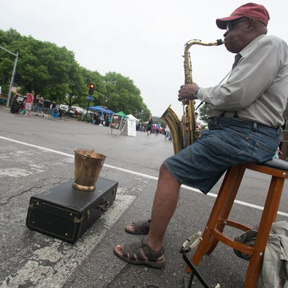 Julius Brooks plays during the Farmer's Market in downtown