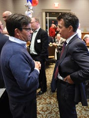 Blair Bowman, left, talks with U.S. Congressman Dave Trott at Novi's Suburban Collection Showplace on Tuesday night. Trott was holding his election night rally at Bowman's convention center.