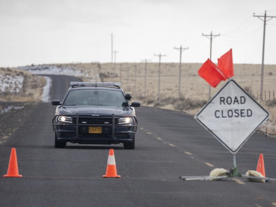 An Oregon State Trooper approaches a road block along