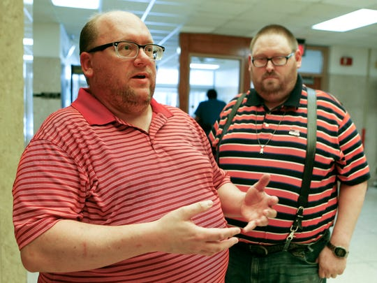 Wade Honey, left, and Dan Barnes, a gay couple, were turned away by the Shawnee County District Court Clerk in Topeka, Kan., on Monday, Oct 6, 2014, when seeking a marriage license in light of the denial by the U.S. Supreme Court to review appeals attempting to prohibit same-sex marriages. (AP Photo/The Capital Journal, Chris Neal)