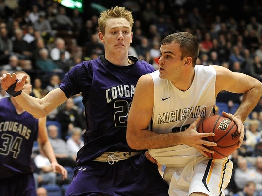Augustana's #32 Casey Schilling looks for an open teammate