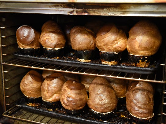 Popovers are ready to be removed from the oven at Anton's
