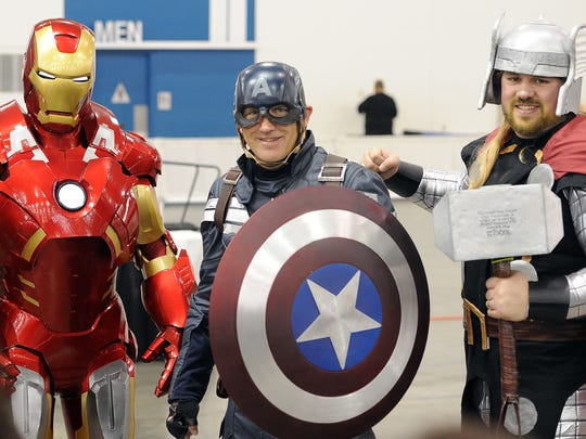 Men dressed as (L-R) Iron Man, Captain America and Thor.