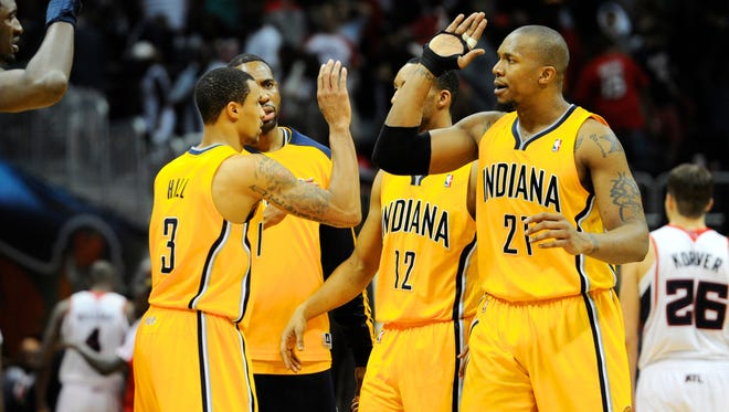Indiana Pacers forward David West (21) reacts with teammates after defeating the Atlanta Hawks in game four at Philips Arena.