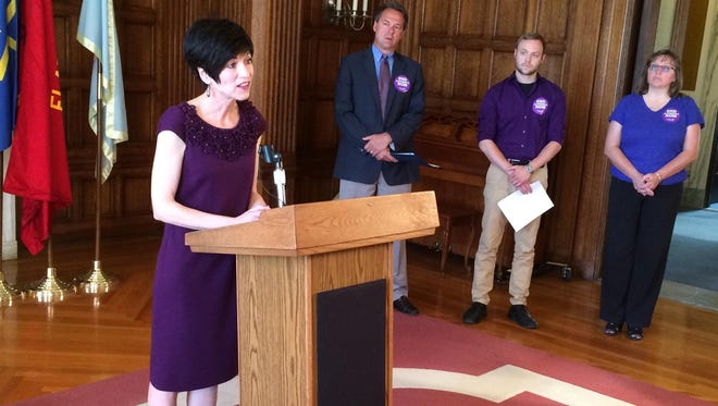 Lynn Mullowney, executive director of the Alzheimer's Association of Montana, speaks Monday at the state Capitol.
