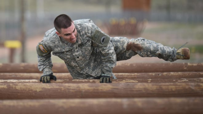 Spc. Jay Eyestone, with the 2-218th Field Artillery Battalion of the Oregon Army National Guard, clears a hurdle on the obstacle course during the Region VI Best Warrior Competition in Wyoming.