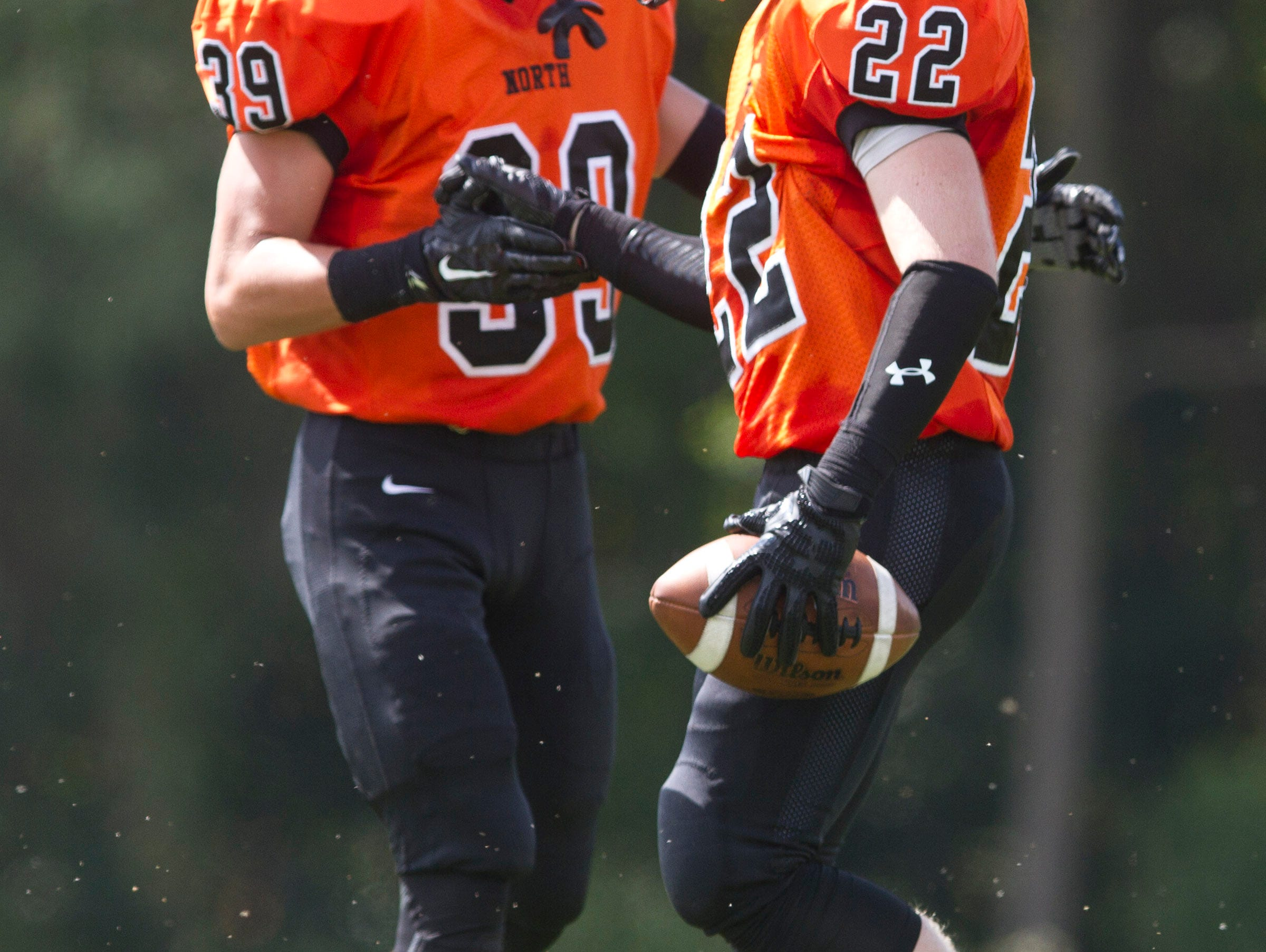 Middletown North's Marc Cerbo (39) celebrates a touchdown by Connor Welsh (22). Middletown North vs Marlboro football. Marlboro, NJ Saturday, September 19, 2015 @dhoodhood