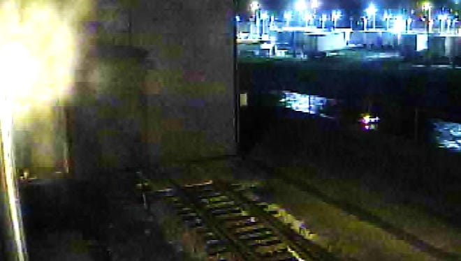 The tail lights of a car can be seen floating in the Kalamazoo River in downtown Battle Creek in this security camera footage.