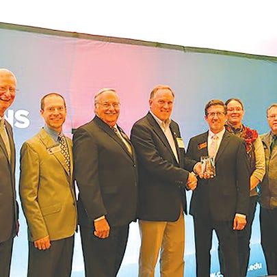 The solar energy education team receives their award