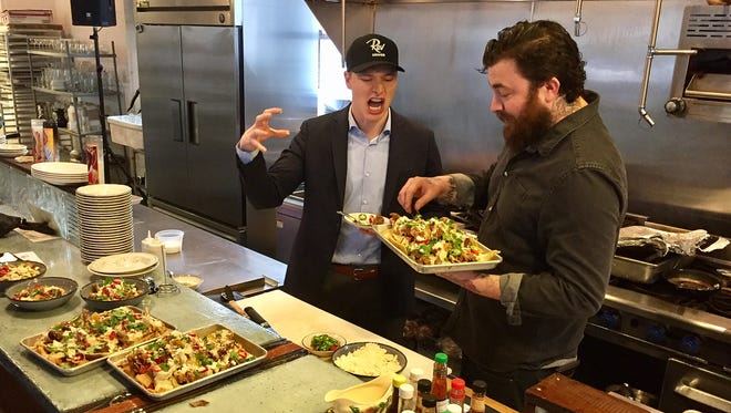 "IndyCar driver Josef Newgarden prepares to attack smoked pork nachos chef Jonathan Brooks is testing for Rev 2017. The pair ate at Milktooth, one of 60 restaurants that will serve tastings at Rev May 6 at Indianapolis Motor Speedway. Newgarden is Rev's honorary chair. The charity event pairs drivers with local chefs to create a massive tasting of ""driver-inspired"" food."