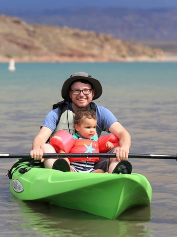Brian Passey kayaks with his nephew, Vale, at Quail