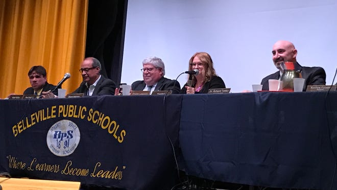 Belleville School board trustees Thomas Grolimond and Ralph Vellon, board attorney Stephen Edelstein, Board of Education President Christine Lamparello and Superintendent Richard Tomko seated during the Monday, March 20, Belleville Board of Education meeting.