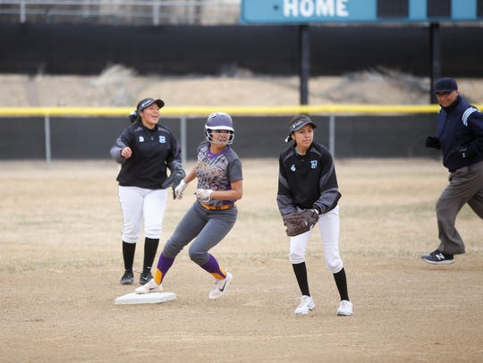Brianna Switzler easily reaches second base following