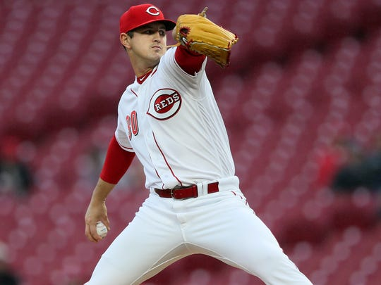 Cincinnati Reds starting pitcher Tyler Mahle (30) delivers in the first inning during the National League baseball game between the Atlanta Braves and the Cincinnati Reds, Tuesday, April 24, 2018, at Great American Ball Park in Cincinnati.