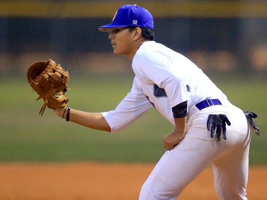 Miller's Jared Cruz watches the pitch against King on Monday, Feb. 13, 2017, at King High School in Corpus Christi.