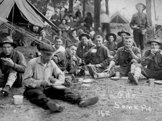 National Guardsmen take time out to eat pie in 1916 while training for the Border War with Mexico. The U.S. Army launched an expedition into northern Mexico in 1916 after Pancho Villa attacked a border town in New Mexico. The photo was taken by Glenn Knox, a Whitewater man who served in the 1st Wisconsin Infantry Regiment during the Border War. Courtesy Wisconsin Veterans Museum