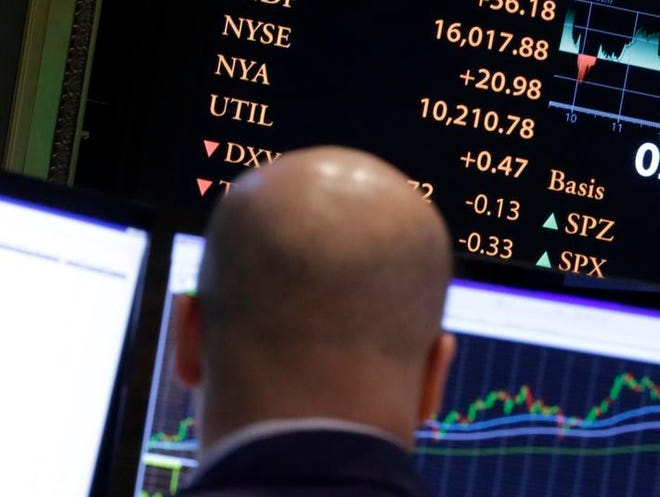 A board on the floor of the New York Stock Exchange shows the Dow Jones industrial average above 16,000 in intraday trading, Monday, Nov. 18, 2013. The stock market broke through two milestones Monday as a historic rally pushes stocks further into record territory.  (AP Photo/Richard Drew)
