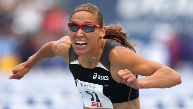 Christopher Gannon/The Register -- 2010 Drake Relays -- Lolo Jones of ASICS, leans for the finish line in the women's 100 meter hurdles special Saturday at the Drake Relays. She was narrowly edged out by Damu Cherry of Nike, at right. (Christopher Gannon/The Des Moines Register)