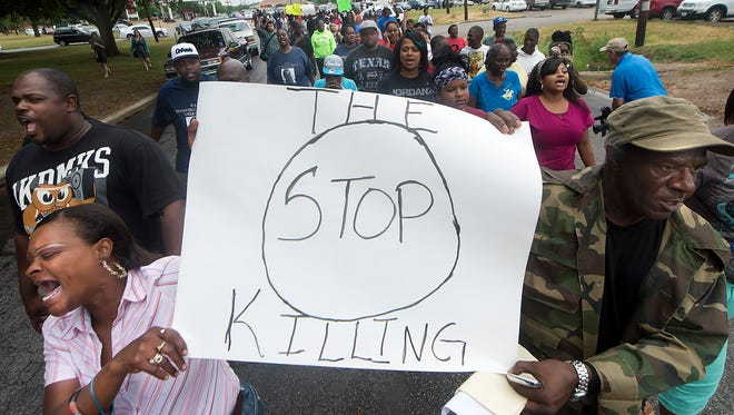 "K.K. Davis, left, and Tommy Jones of Hearne carry a sign with other protesters outside the Hearne, Texas police department Thursday, May 8, 2014 following the Tuesday shooting of 93-year-old woman. Robertson County District Attorney Coty Siegert said Pearlie Golden was shot Tuesday night by Officer Stephen Stem. Stem was responding to a 911 call about a disturbance involving a woman with a gun. The Hearne Police Department says Golden ""brandished a firearm"" when Stem encountered her. He then shot her multiple times. The investigation into the shooting is being handled by the Texas Rangers.  (AP Photo/Bryan College Station Eagle, Stuart Villanueva)"