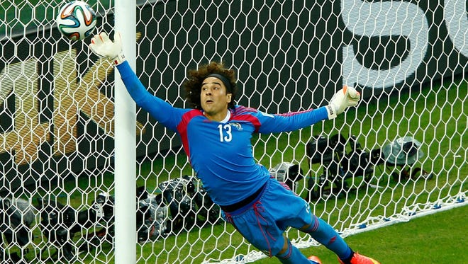 Mexico's Guillermo Ochoa jumps to save the ball during their 2014 World Cup Group A soccer match against Brazil at the Castelao arena in Fortaleza, June 17, 2014.