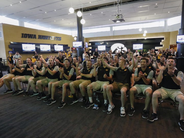 The Hawkeyes celebrate their bracket revealing at Monday's