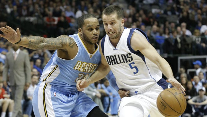 Guard J.J. Barea (right) played a key role in the Mavericks' run to the NBA championship in 2011.