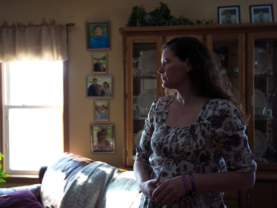 Missy Ojibway stands in her home in Jim Falls, Wis.,