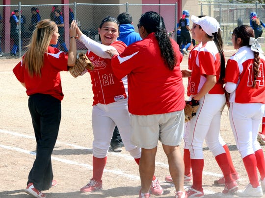 Loving celebrates a double play made by senior first baseman Clarissa Calderon (21) in the top of the third inning Thursday against Dexter.