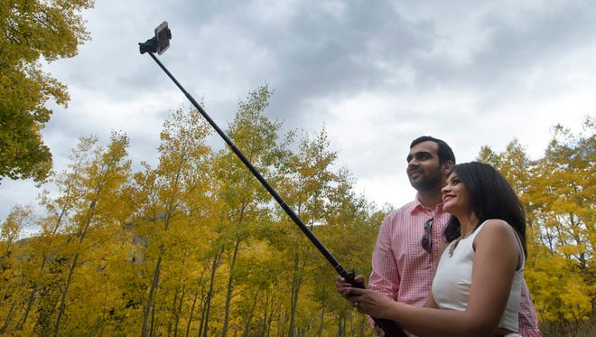 Vastal Thakkar and Nirali Patel, visiting from Chicago, snap a selfie as they enjoy the fall colors near Crested Butte, Colorado on Friday, September 22, 2017. The aspen trees in the area are reaching their peak fall coloration.