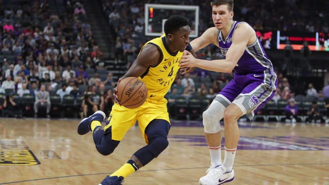 Mar 29, 2018; Sacramento, CA, USA; Indiana Pacers guard Victor Oladipo (4) dribbles the ball around Sacramento Kings guard Bogdan Bogdanovic (8) during the first quarter at Golden 1 Center. Mandatory Credit: Sergio Estrada-USA TODAY Sports