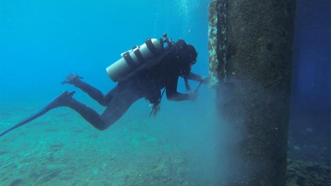 An Appledore Marine Engineering diver works underwater at the Carnival Cruise Cneter in Cozumel, Mexico.