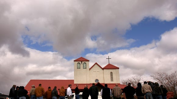 In this  Nov. 10, 2008, photo, mourners at a  funeral