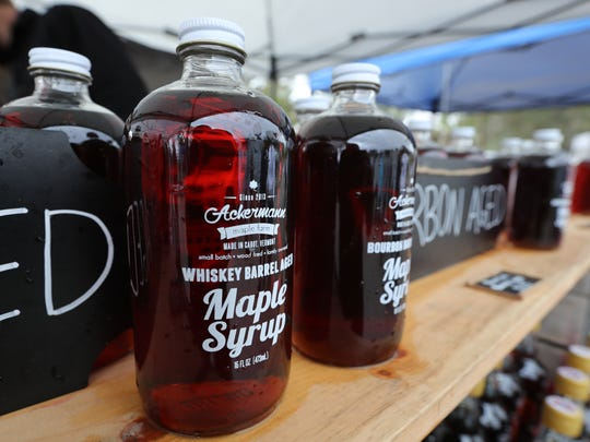 An assortment of maple syrup is on display at the Lakes Park Farmers Market  from Ackermann Farms.