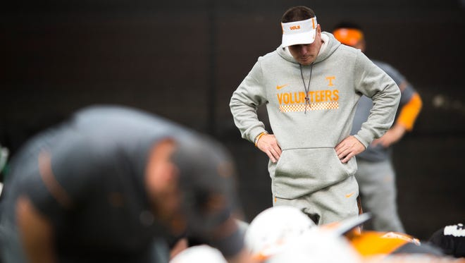 Tennessee head coach Butch Jones watches his team warm up during football practice on Tuesday, Nov. 7, 2017.