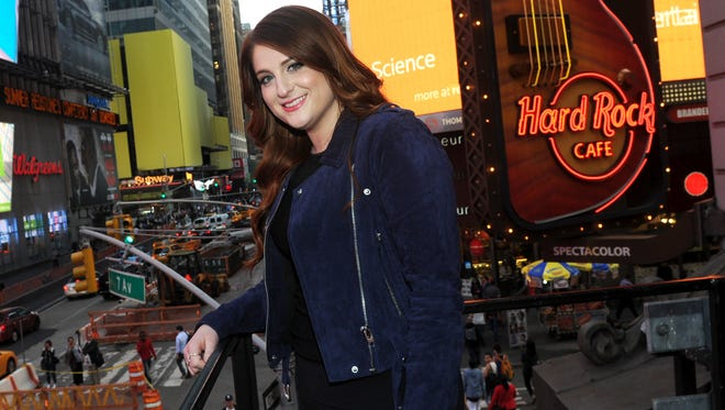 Meghan Trainor poses in Times Square Monday, hours after pulling her 'Me Too' music video off YouTube.