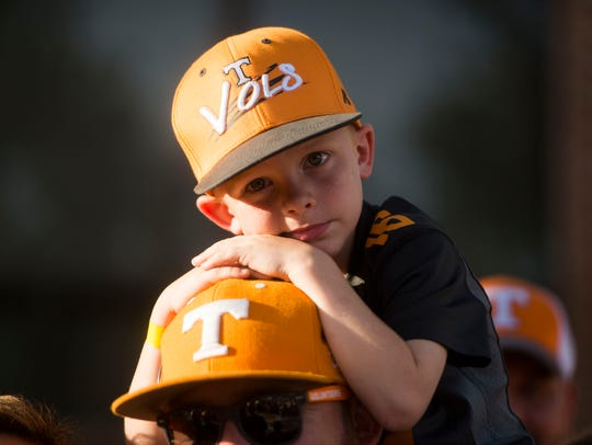 A young Vol fan rests while waiting for the Vol Walk