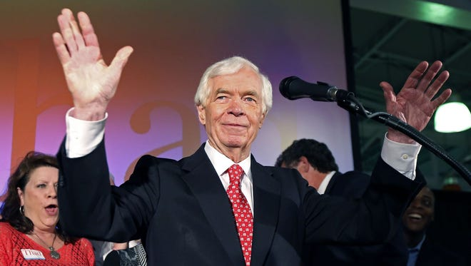 U.S. Sen. Thad Cochran, R-Miss., waves to supporters and volunteers at his runoff election victory party Tuesday, June 24, 2014 in Jackson, Miss.