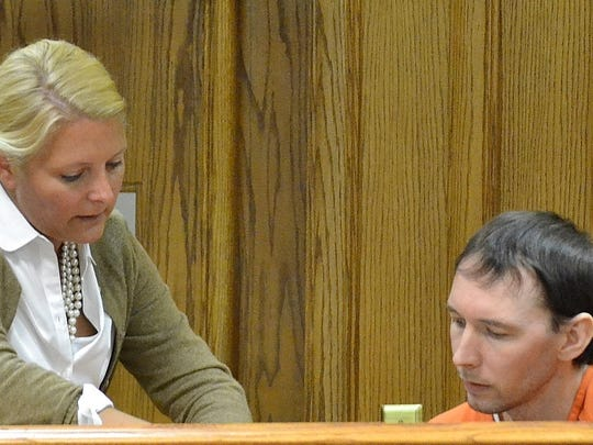 Special prosecutor Wendy Lemkuil shows Shawn Paholke a transcript of his statements in an April hearing during which he entered no contest pleas six child abuse charges. Paholke was in court Thursday, Aug. 6, seeking to withdraw those pleas.