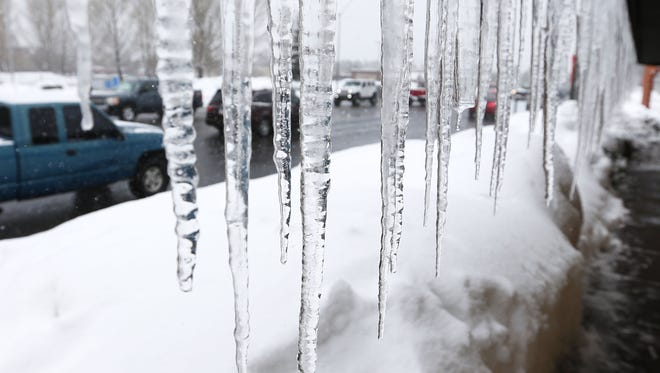 Icicles form on a restaurant in Flagstaff January 22, 2017.