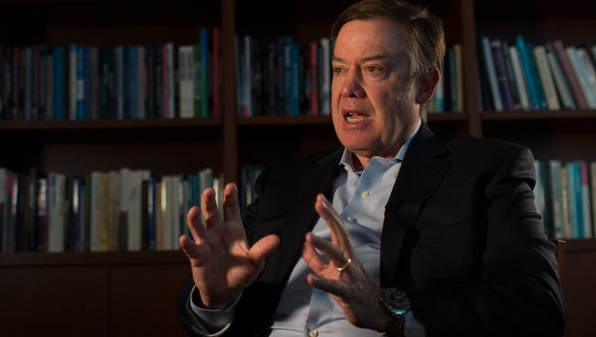 Arizona State University president Dr. Michael Crow speaks with Doug Haller in his office at ASU on March 1, 2018 in Tempe, Ariz.