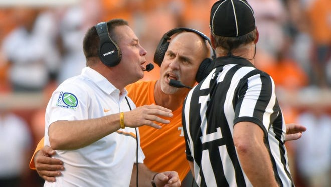 Tennessee defensive backs coach Willie Martinez tries to pull coach Butch Jones back from the referee during the Vols' 38-28 win over Florida on Sept. 24 at Neyland Stadium.