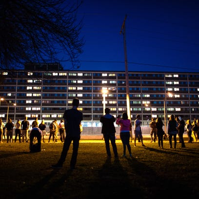 Residents of University of Iowa's Mayflower Hall turned on their room lights to spell out I-O-W-A on the side of the building along Dubuque Street.