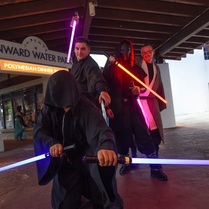 Force Federation of Guam members Ethan Sothman, right, and Lucas Sidor, left, have a lightsaber duel during Neo-Con 2016 at Onward Beach Resort in Tamuning on April 30.