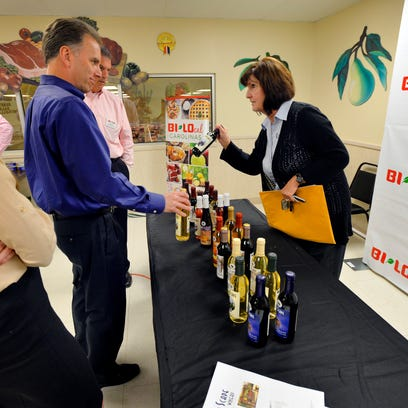 Anita Tamme, owner of City Scape Winery in Pelzer, pitches her wines to representatives of BI-LO at a recent event the store held to recruit local producers.